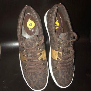 MK monogram brown sneakers.